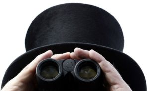 A racegoer uses his binoculars on the first day of racing at Royal Ascot in southern England June 15, 2010.   REUTERS/Luke MacGregor (BRITAIN - Tags: SPORT HORSE RACING SOCIETY)