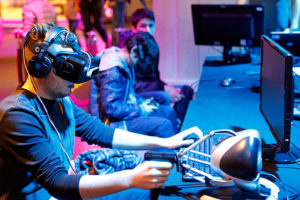 PARIS, FRANCE - DECEMBER 23:  A gamer plays a game with the virtual reality head-mounted display 'Oculus Rift' during the 'Noel de Geek' at the Cite des Sciences et de l'industrie on December 23, 2014 in Paris, France. The display transfers the eye movements to the game in real time. 'Noel de Geek' takes place from December 23, 2014 till January 04, 2015.  (Photo by Chesnot/Getty Images)